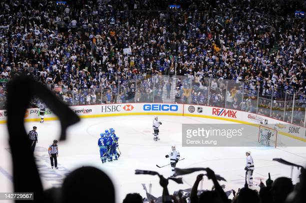 Fans wave their towels to celebrate the goal of Alexander Edler of the Vancouver Canucks on Jonathan Quick of the Los Angeles Kings in Game One of...