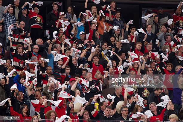 Fans wave white towels during player introductions prior to a game between the Ottawa Senators and the Pittsburgh Penguins in Game Three of the...