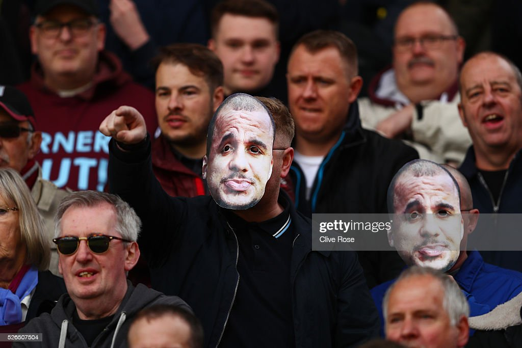 Fans wear Gabriel Agbonlahor of Aston Villa masks prior to the Barclays Premier League match between Watford and Aston Villa at Vicarage Road on April 30, 2016 in Watford, England.
