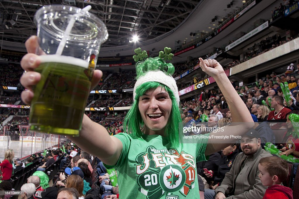 Fans wear green to celebrate Saint Patrick's Day during an NHL game between the Ottawa Senators and the Winnipeg Jets at Scotiabank Place on March 17, 2013 in Ottawa, Ontario, Canada.