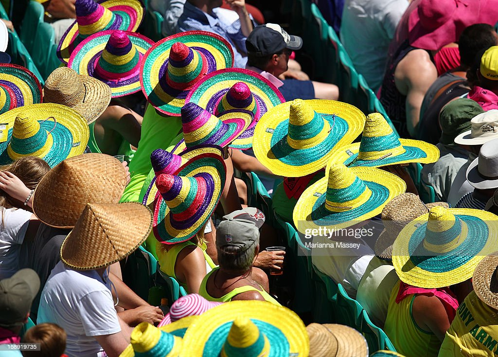 Fans wear hats to keep cool during day two of the Third Test match between Australia and Sri Lanka at Sydney Cricket Ground on January 4, 2013 in Sydney, Australia.
