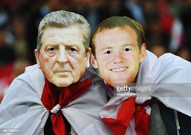 Fans wear Roy Hodgson and Wayne Rooney masks prior to the UEFA EURO 2016 Group E qualifying match between England and Switzerland at Wembley Stadium...