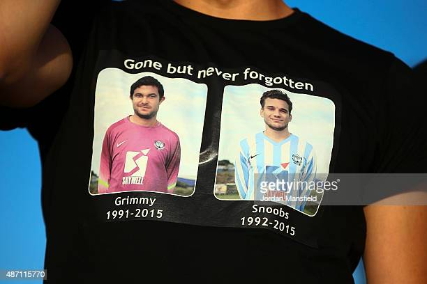 Fans wear shirts dedicated to the memory of Matthew Grimstone and Jacob Schilt two Worthing United players who lost their lives in the Shoreham...