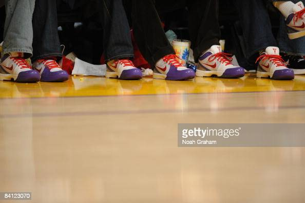 Fans wear the Nike Kobe Zoom IV shoe while sitting courtside during a game between the Boston Celtics and the Los Angeles Lakers at Staples Center on...