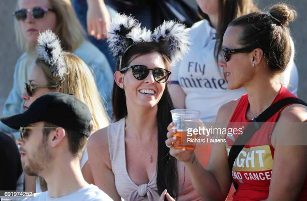 TORONTO ON JUNE 3 Fans wear wolf ears in support of the team and enjoy a refreshing beverage Canada's first professional rugby team the Toronto...