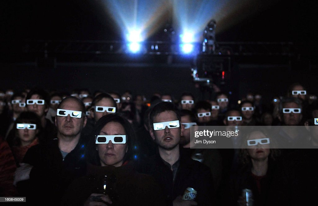 Fans wearing 3-D glasses watch German electronic pioneers Kraftwerk perform live on stage during the first night of their Catalogue 12345678 retrospective at the Tate Modern Turbine Hall on February 6, 2013 in London, England.