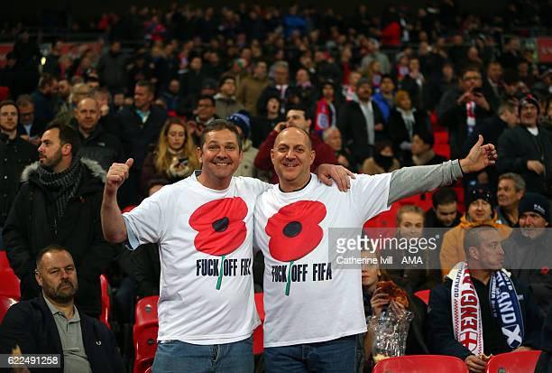 Fans wearing a poppy shirt protesting against FIFA during the FIFA 2018 World Cup Qualifier between England and Scotland at Wembley Stadium on...
