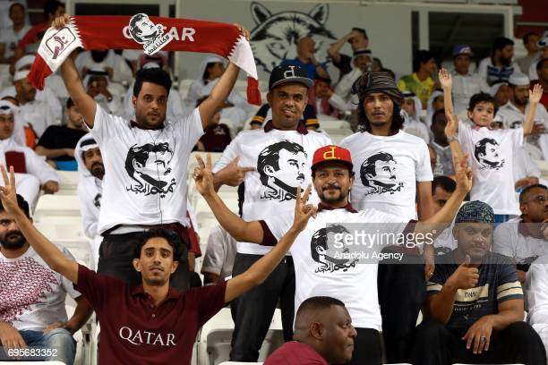 Fans wearing Emir of Qatar Tamim bin Hamad Al Thani's photos printed tshirts support their teamduring the 2018 FIFA World Cup Asian Qualifying group...