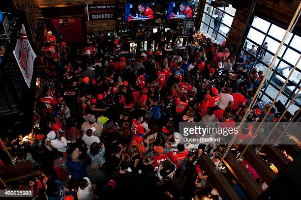 Fans wearing orange fill the floor in the first half of Super Bowl XLVII between the Denver Broncos and the Seattle Seahawks at the Viewhouse bar in...