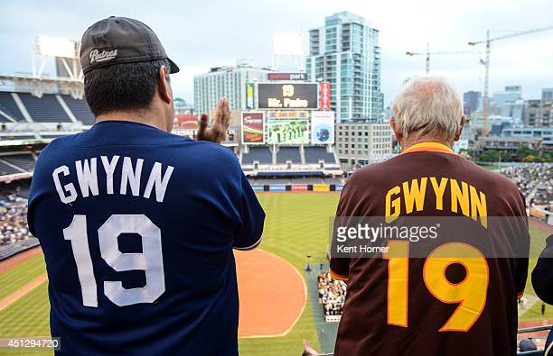 Fans wearing replica jerseys stand for the opening ceremonies celebrating Hall of Famer Tony Gwynn Sr's life and career as a San Diego Padre at Petco...