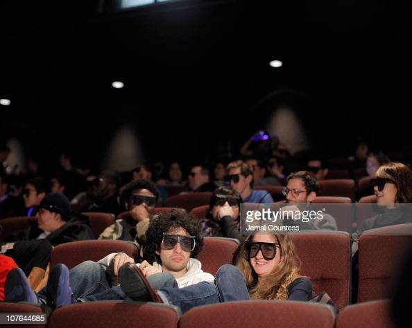 Fans wearing their 3D glasses in the theater prior to the screening of 'TronLegacy' at the IMAX 'Tron Legacy' fan celebration at AMC Lincoln Square...
