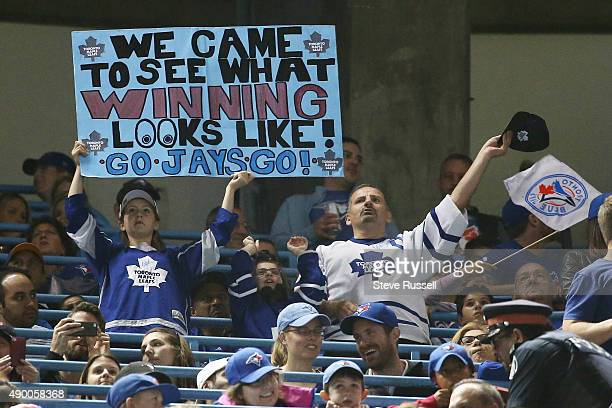 TORONTO ON SEPTEMBER 25 Fans wearing Toronto Maple Leafs jerseys have some fun with them as the Toronto Blue Jays open a three game series against...