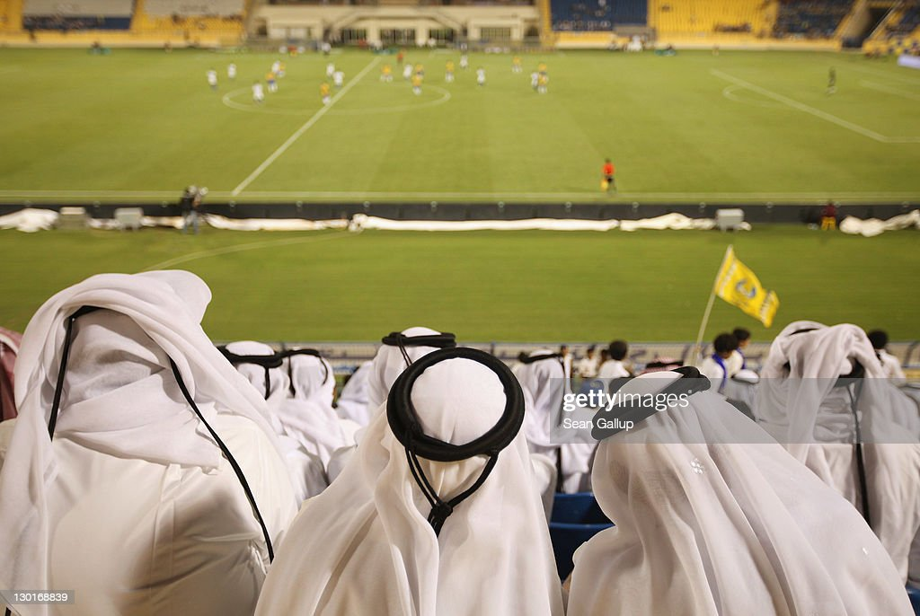 Fans wearing traditional local dress attend the Gharafa vs. Kharaitiyat Qatar Stars League football match at Al Gharafa Stadium on October 23, 2011 in Doha, Qatar. Qatar will host the 2022 FIFA World Cup football competition and is slated to tackle a variety of infrastructure projects, including the construction of new stadiums.