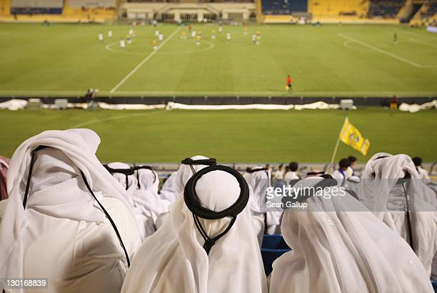 Fans wearing traditional local dress attend the Gharafa vs Kharaitiyat Qatar Stars League football match at Al Gharafa Stadium on October 23 2011 in...