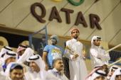 Fans wearing traditional local dress attend the Gharafa vs Kharaitiyat Qatar Stars League football match at Al Gharafa Stadium on October 23 2011 in...