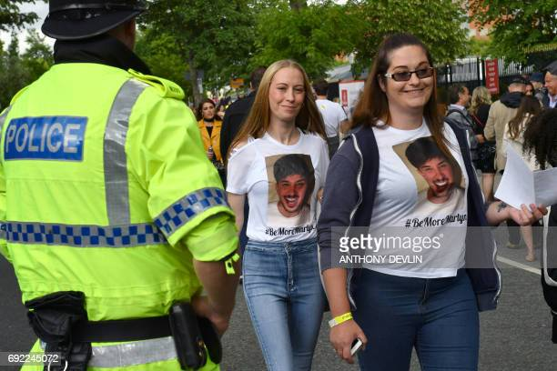 Fans wearing Tshirts bearing a tribute to Martyn Hett a victim of the May 22 terrorist attack arrive at at the Old Trafford Cricket Ground ahead of...