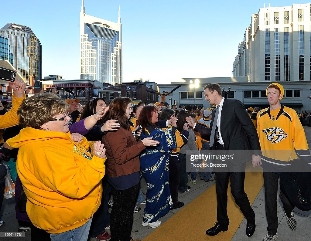 Fans welcome <a gi-track='captionPersonalityLinkClicked' href=/galleries/search?phrase=Pekka+Rinne&family=editorial&specificpeople=2118342 ng-click='$event.stopPropagation()'>Pekka Rinne</a> of the Nashville Predators to the Bridgestone Arena prior to the season opener against the Columbus Blue Jackets on January 19, 2013 in Nashville, Tennessee.