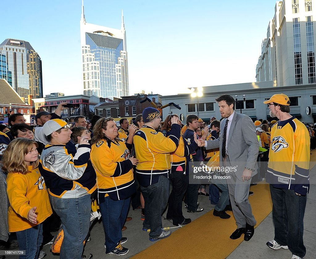 Fans welcome <a gi-track='captionPersonalityLinkClicked' href=/galleries/search?phrase=Shea+Weber&family=editorial&specificpeople=554412 ng-click='$event.stopPropagation()'>Shea Weber</a> of the Nashville Predators to the Bridgestone Arena prior to the season opener against the Columbus Blue Jackets on January 19, 2013 in Nashville, Tennessee.