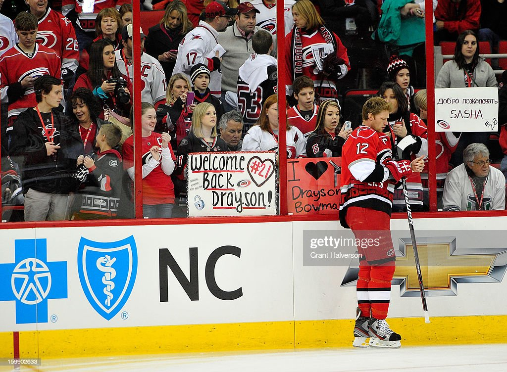 Fans welcome the players to the ice before a game between the Tampa Bay Lightning and the Carolina Hurricanes during play at PNC Arena on January 22, 2013 in Raleigh, North Carolina.