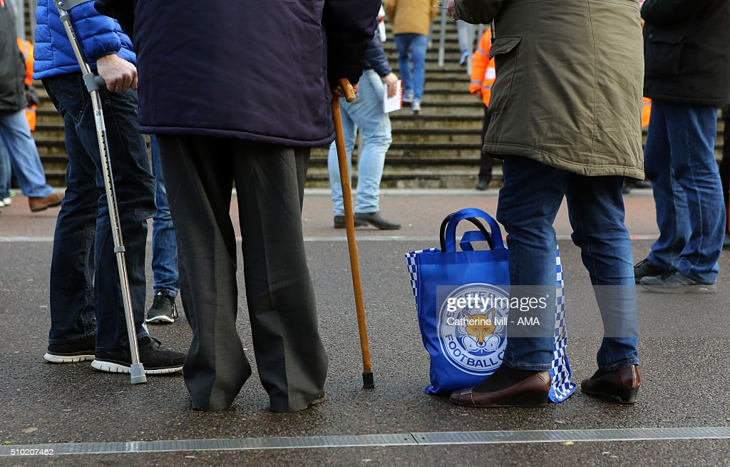 Fans with a Leicester City bag the Barclays Premier League match between Arsenal and Leicester City at the Emirates Stadium on February 14, 2016 in London, England.