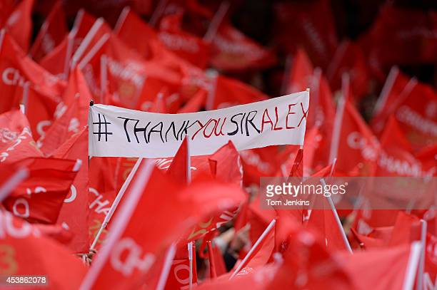 Fans with banners and flags during the Manchester United versus Swansea City FA Premier League match the final home game for Sir Alex Ferguson as...