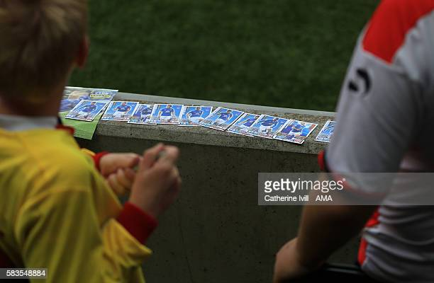 fans with Everton trading cards during the PreSeason Friendly match between Milton Keynes Dons and Everton at Stadium mk on July 26 2016 in Milton...