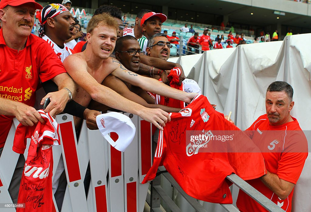 Fans with John Aldridge during the Legends match between Liverpool FC Legends and Kaizer Chiefs Legends at Moses Mabhida Stadium on November 16, 2013 in Durban, South Africa.