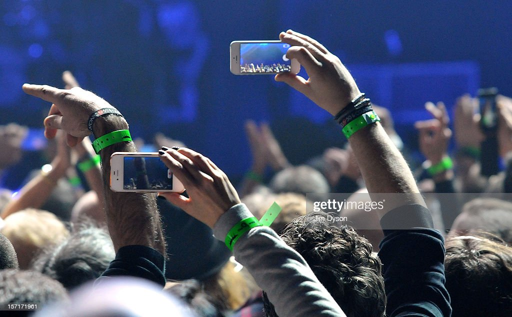 Fans with mobile phone cameras wait for The Rolling Stones to take to the stage at O2 Arena on November 29, 2012 in London, England.