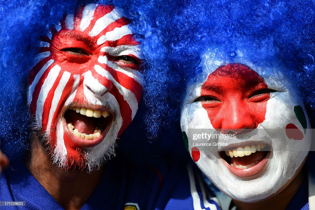 Fans with painted faces pose for a photo during the FIFA Confederations Cup Brazil 2013 Group A match between Japan and Mexico at Estadio Mineirao on June 22, 2013 in Belo Horizonte, Brazil.