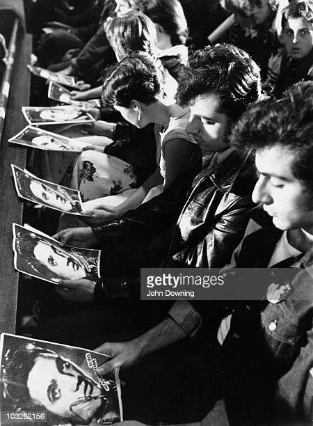 Fans with special prayer sheets at a memorial service for Elvis Presley held in London three days after the singer's death 18th August 1977