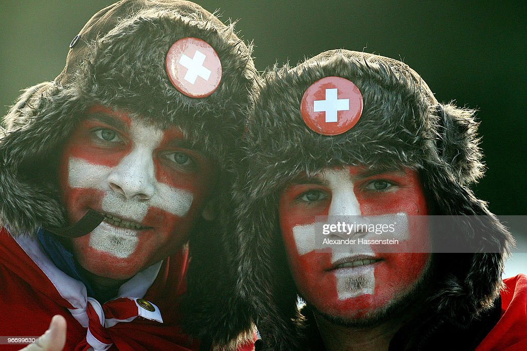 Fans with the Swiss flag painted on their face pose during the finals of the Men's Singles Luge on day 3 of the 2010 Winter Olympics at Whistler Sliding Centre on February 14, 2010 in Whistler, Canada.