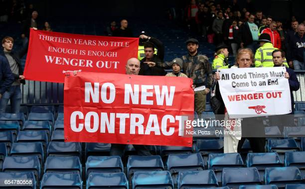 Fans with Wenger Out banners in the stands during the Premier League match at The Hawthorns West Bromwich