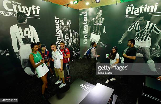 Fans work their way through an exhibit room at the 2015 UEFA Champions League Trophy Tour presented by Heineken exhibition on April 18 2015 in Dallas...
