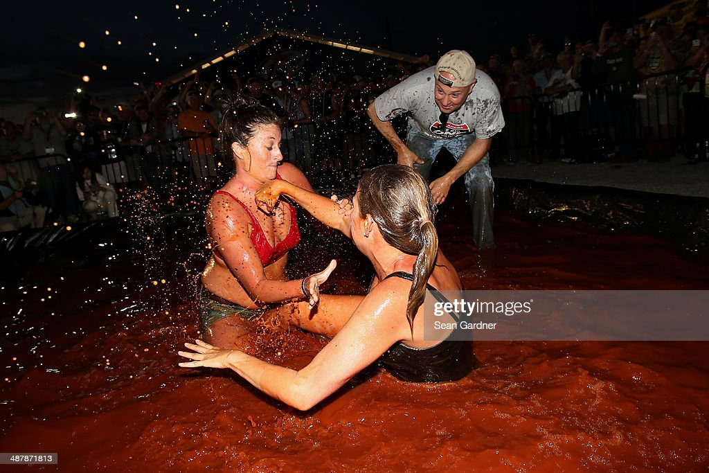 Fans wrestle in barbecue sauce in the infield following qualifying for the NASCAR Nationwide Series Aaron's 312 at Talladega Superspeedway on May 2, 2014 in Talladega, Alabama.