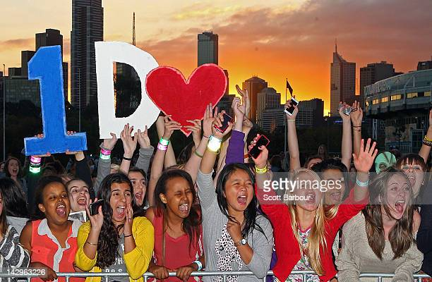 Fans yell as they wait for the gates to open outside of the One Direction concert at Hisense Arena on April 16 2012 in Melbourne Australia