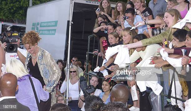 Fans yell out to actress Julia Roberts left after she finishes an interview at the film premiere of Colombia Pictures'' 'America''s Sweethearts' July...