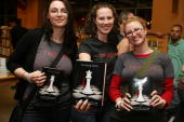 Fans/customers purchase the fourth book 'Breaking Dawn' in the 'Twilight' series at the 'Breaking Dawn' Midnight Release Party at Borders Michigan...
