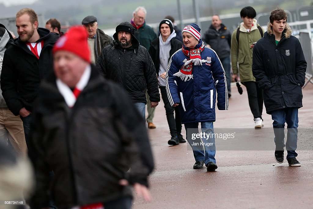 Fanss arrive ahead of the Barclays Premier League match between Stoke City and Everton at Brittania Stadium on February 06, 2015 in Stoke on Trent, England.