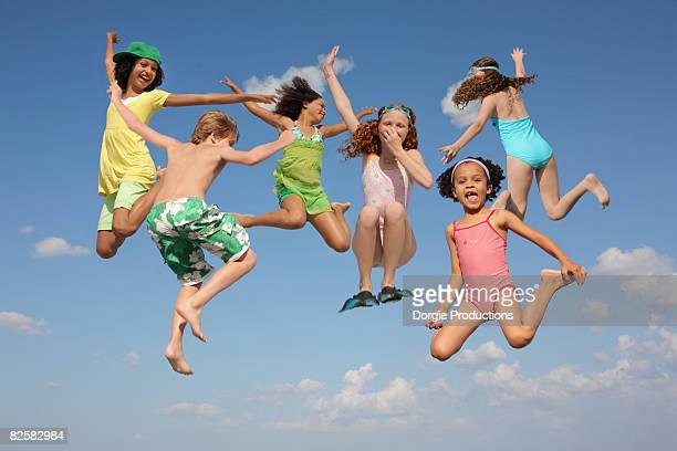 Fantastic group of kids jumping happily together