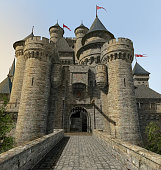 3D rendering of a draw bridge gate of a massive  enchanted fantasy castle seen from a stone bridge.