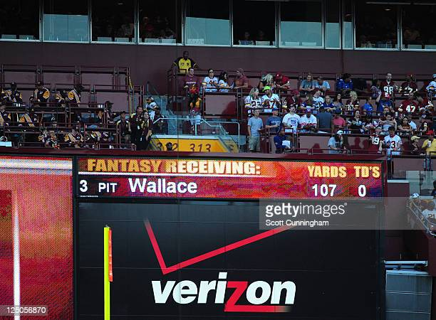 Fantasy football statistics are shown on the scoreboard during the game between the Washington Redskins and the New York Giants at FedEx Field on...