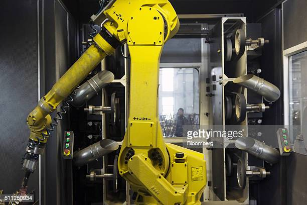 A Fanuc Corp robotic arm operates at a faucet manufacturing plant of HSIL Ltd in Bhiwadi Rajasthan India on Tuesday Feb 16 2016 Prime Minister...