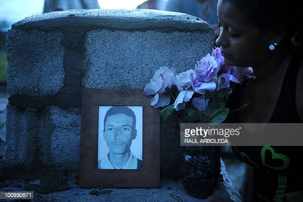 Fany Mejia looks at the tomb of her father Ivan Mejia murdered by rightwing paramilitary guerrillas 15 years ago after his burial at the cemetery of...