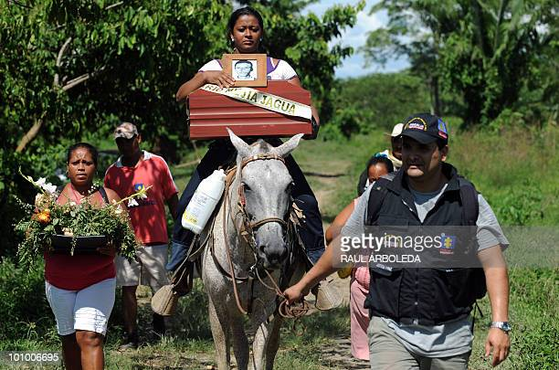 Fany Mejia rides back home carrying the urn with the remains of her father Ivan Mejia in Santa Maria municipality Choco department Colombia on May 22...