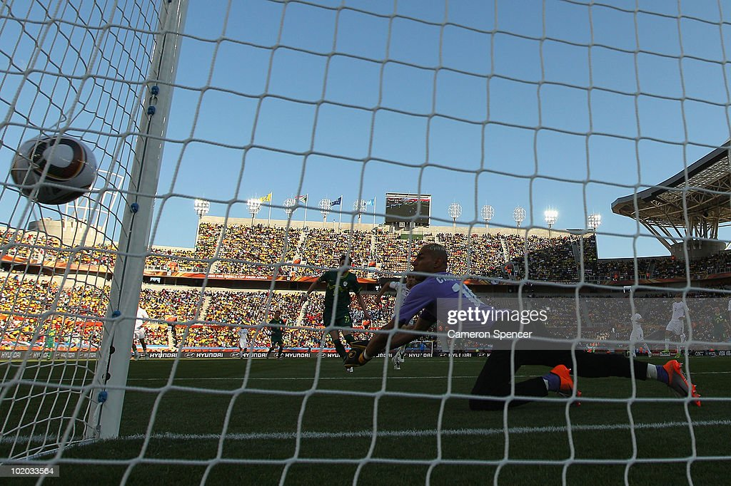 Faouzi Chaouchi of Algeria misjudges the flight of the ball and allows Robert Koren of Slovenia to score from long range during the 2010 FIFA World Cup South Africa Group C match between Algeria and Slovenia at the Peter Mokaba Stadium on June 13, 2010 in Polokwane, South Africa.