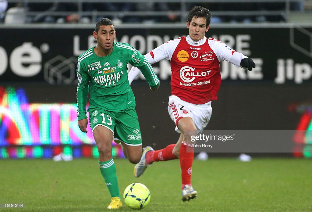 Faouzi Ghoulam of ASSE dribbles Aissa Mandi of Reims during the french Ligue 1 match between Stade de Reims and AS Saint-Etienne at the Stade Auguste Delaune on February 17, 2013 in Reims, France.