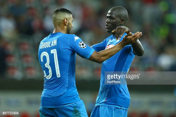 Faouzi Ghoulam of Napoli and Kalidou Koulibaly of Napoli celebrate after the UEFA Champions League Qualifying PlayOffs round second leg match between...
