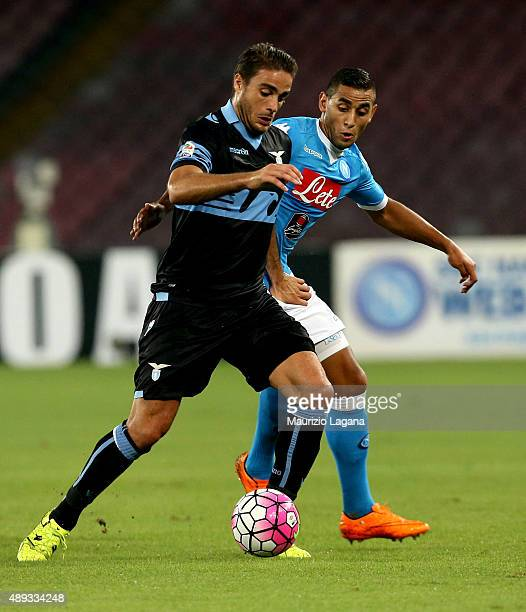 Faouzi Ghoulam of Napoli competes for the ball with Alessandro Matri of Lazio during the Serie A match between SSC Napoli and SS Lazio at Stadio San...