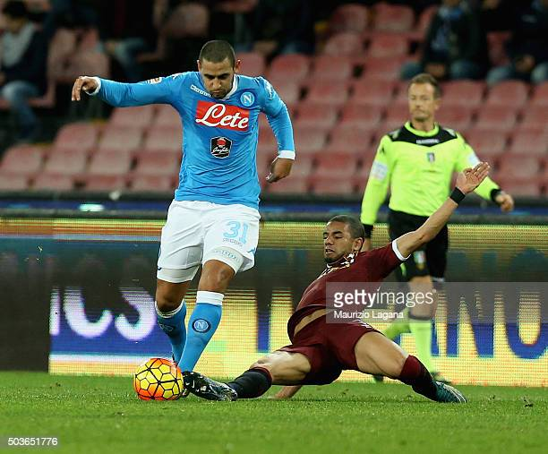 Faouzi Ghoulam of Napoli competes for the ball with Bruno Peres of Torino during the Serie A match between SSC Napoli and Torino FC at Stadio San...