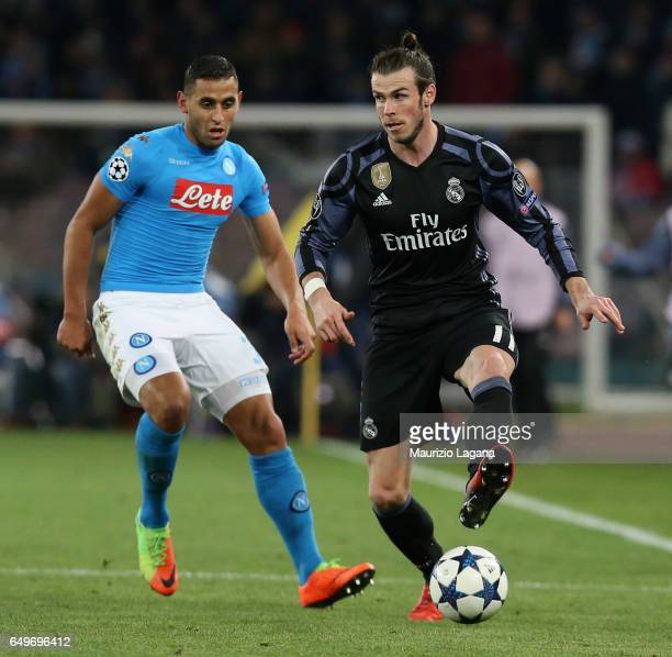 Faouzi Ghoulam of Napoli competes for the ball with Gareth Bale of Real Madrid during the UEFA Champions League Round of 16 second leg match between...